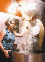 Judy Rogers roasting coffee at Prime Roast Coffee in Keene, NH. Photo from the Keene Sentinel.