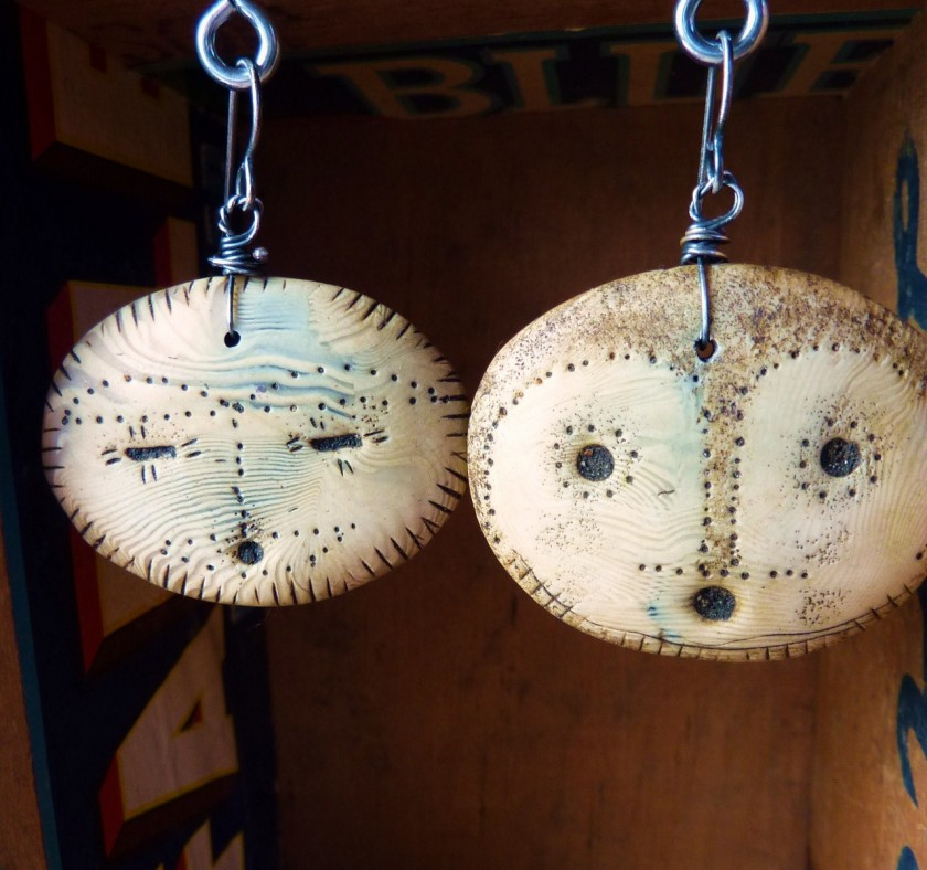 Unmatched shaman mask earrings, in faux ivory--polymer clay