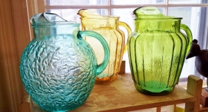 A rainbow of vintage glass pitchers for your table!