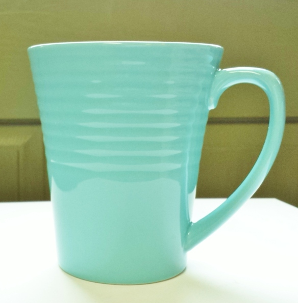 Why do I love this mug? Big (16 oz.), beautiful aqua color, holds the heat, flat bottom that doesn't collect water in the dishwasher.