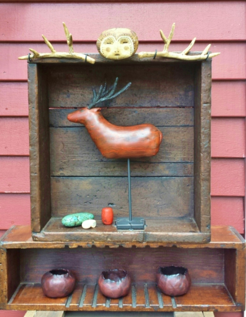 I made the deer last year, but I didn't know what I was going to do with him til a few months ago. Everything in this display is polymer clay (except the antique boxes.)