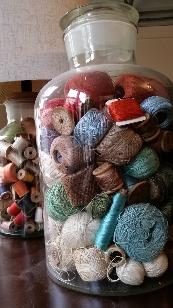 Jar of mixed threads (not very accessible) and the jar lamp with old thread behind.